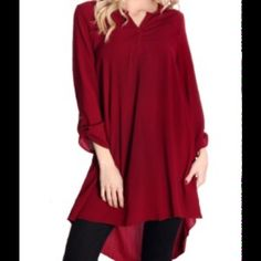 NWT TODAY ONLY $25.00 chic tunic top! Subtle V-neck 3/4 sleeve tunic that can be paired with leggings or skinny jeans. Excellently fabricated olive v-neck blouse is equipped with buttoned sleeves and trendy tunic length. Burgundy. Tops Tunics