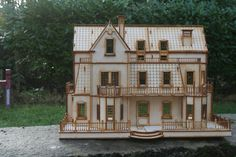 Gothic Villa Dolls House    Made from 3mm Birch Ply.    This house has a number of rooms with 2 flights of stairs and 3 floors. The back of the house