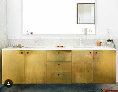 @dominomag love. Idea to resurface and flatten loathsome paneled kitchen cabinets.