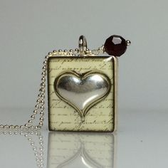 Sliver heart Scrabble tile charm necklace:$16.00 All wrapped up in a White organza bag with a valentine gift tag, all ready for gift giving.  by ScrabbleChick