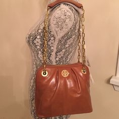 """NWT Tory Burch Description dens mini bag. Brand new Tory Burch description dens mini bag. Color luggage. Come dust bag shipping bag. Gold chain, the strap can be used on one side or evened out to two. Dimensions: 9""""L X 6""""W X 7""""H. ❌No trade. Tory Burch Bags Crossbody Bags"""
