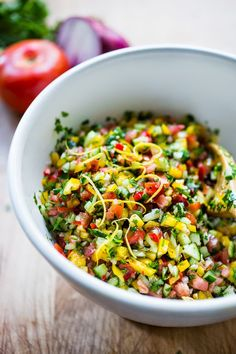 Israeli Salad- chopped veggies, fresh herbs an and a simple lemony dressing - healthy and light, great for detoxing.... and SO delicious!  | www.feastingathome.com