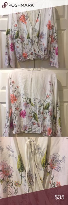 Lovestitch • Floral bell sleeve hippie top Like New, never worn! This is a bell sleeved hippie blouse with a floral print and deep v-neckline, by Lovestitch. Super soft and flowy. Pair with a long maxi skirt, cutoff shorts, or even just a snug pair of denim. Super comfy and hippie chic! Lovestitch Tops Blouses