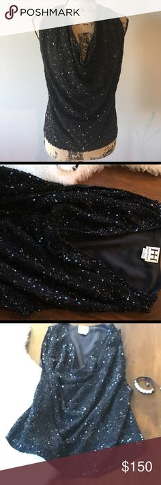 """Haute Hippie sequined cowl neck black top Authentic Haute Hippie cowl neck sequined top size XS. Worn once like new condition. Super sparkly. You can wear it with formal wear to a wedding or with jeans to a club. Comfortable and a real head turner. Fully lined. Measures approximately 22.5"""" from shoulder to hem in front and 19.5"""" in length in the back. Haute Hippie Tops Tank Tops"""