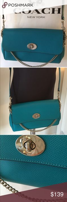 🆕SALE! COACH NEW SHOULDER/ CROSSBODY BAG 💯AUTH SALE PRICE IS FIRM! COACH NEW NEVER USED WITH TAG TURQUOISE LEATHER SHOULDER/ CROSSBODY BAG 💯AUTHENTIC. SO STUNNING AND STYLISH AND PERFECT FOR THE WOMAN ON THE GO. TWO ROOMY INTERIOR WALL POCKETS AND A REAR OUTSIDE POCKET. A GREAT BAG! HAS A REMOVABLE CHAIN SHOULDER STRAP AND LONG REMOVABLE AND ADJUSTABLE LONG SHOULDER/ CROSSBODY STRAP. THE BAG MEASURES 10.75 INCHES WIDE AND 6 INCHES TALL. THE TAG CAME OFF THE STRING BUT IT IS STILL PRESENT…