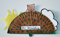 Paper Plate Pop-up Groundhog. Lots of cool paper plate crafts on this site.