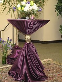 Love the way the table cloth pools on the floor... not so much the color.