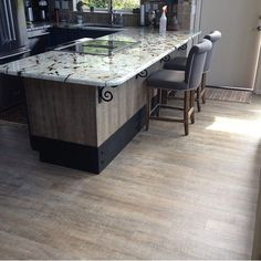 Beautiful kitchen! The flooring is our COREtec Boardwalk Oak on the floor and around the kitchen island! Big shout-out to Alsea Bay Granite Interiors! #kitchen #flooring #COREtec