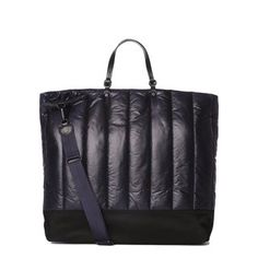 A new addition for AW14, the Aspen is the ultimate sporty chic tote, inspired by winter sport and snowy mountains. Made from a sleek, channel quilted nylon with a Bedford Nylon bottom and black leather handles, the Aspen is ultra lightweight and roomy. With custom MZ Wallace black hardware and black edge-dye.