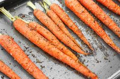 Sweet and flavourful easy garlic and herb roasted carrots is the perfect side dish to your holiday (Easter) or everyday dinner!   aheadofthyme.com