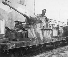A Panzer 4 chassis modified to a flat car to be operated as part of an armored Panzerzug military train