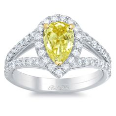 The pear canary yellow diamond engagement ring is another lovely trend that the designers of the Bel Dia line of yellow diamond halo engagement rings are ready to deliver. Rather than compete with this diamond's rare shape as a round halo would do, the gorgeously accented halo setting for this exclusive pear-shaped setting will snugly trace along its edge, molding to the shape perfectly. The G color/VS clarity diamonds line the halo portion itself and the split shank band, available in a…