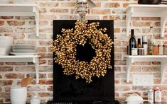 gold wreath may be neat at the base of the cake stand