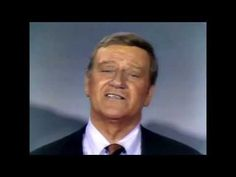 """John Wayne 1970 - """"Legendary actor John Wayne in a clip from 1970 on the TV variety show he hosted celebrating America's history. Many famous actors and actresses are featured in this video singing 'God Bless America'..."""""""