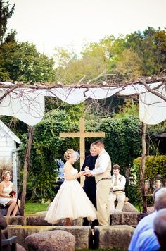 Love this beautiful branch canopy for the ceremony.