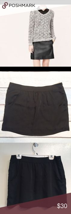 "NWT Ann Taylor LOFT Black Sateen Mini Skirt New with tag. Ann Taylor LOFT black semi shiny sateen type skirt. Has pockets and zips up the side. Hidden elastic in the middle of the waist. Size 14. Measures 19"" flat at waist and 16.5"" long. No modeling. Smoke free home. I do discount bundles. LOFT Skirts"