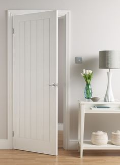 Modern Interior Doors Ideas Choosing Modern Interior Doors for Your Home Modern Interior Doors Ideas. Interior doors are as important as exterior doors. Within a home or a building, interior doors … White Interior Doors, White Doors, Wooden Interior Doors, Cottage Doors Interior, White Wooden Doors, Interior Door Styles, Beach Style Interior Doors, Beach Style Doors, Grey And White Hallway
