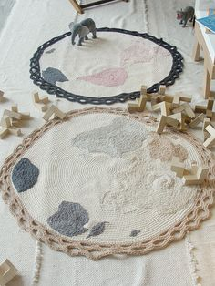 two world map carpets hand embroidered by miga de pan