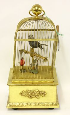 A musical birdcage automaton, mid 20th century, the two singing feathered birds with moving heads and beaks, by Reuge Music, Sainte-Croix, Switzerland £400-600 10th September 2014