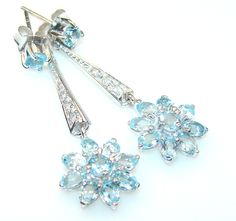 $59.85 Delicate Swiss Blue Topaz Sterling Silver earrings at www.SilverRushStyle.com #earrings #handmade #jewelry #silver #topaz