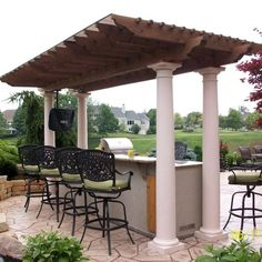 Custom Wood Outdoor Pergola Covering a Grill Island & Hanging Television
