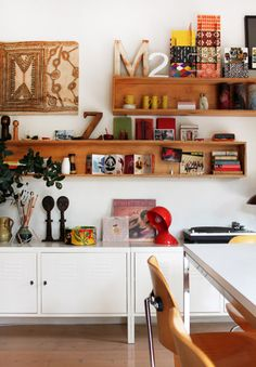 Box Shelving like this appeals to me. It can be clean and streamlined or cluttered and awesome. Also, the painting options are large.
