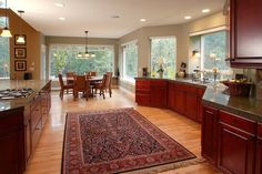 Large, open kitchen design with red cherry cabinets and a persian rug. Discovered on www.Porch.com Kitchen Cabinet Colors, Kitchen Colors, Kitchen Cabinets, Kitchen Design Open, Open Kitchen, Craftsman Furniture, Home Porch, Cherry Cabinets, Furniture Styles