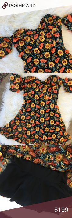 NWT For Love and Lemons Black Floral Mini Dress Fun and flirty mini dress. Black with yellow and red flowers throughout. Shoulder sleeves are including. Wiring in the bust area, pictured in last photo. Lined underneath. For Love And Lemons Dresses Mini