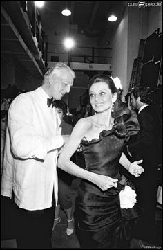 "The French fashion designer Hubert de Givenchy photographed with his muse Audrey Hepburn in the backstage installed at the Fashion Institute of Technology in New York City, New York (USA), before a fashion show opening the exhibition called ""Givenchy: 30 Years"", celebrating the 30 years of his famous Maison Givenchy, on May 10, 1982."