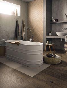 Pour une salle de bains chaleureuse at authentique, mettez une petite touche de bois ! Les revêtements de sol en grés cérame ont la côte et imitent parfaitement le bois avec un choix de nuances très varié. Besoin d'inspirations ?  Un projet d'aménagement ou de rénovation ? Contactez-nous!  #bois #wood #grescerame #salledebains #bains #bathroom #deco #design #interieur #maison #decoration #scandinave #nature #carrelage Wood Effect Porcelain Tiles, Wood Effect Tiles, Wood Tile Floors, Flooring, Ceramic Tile Bathrooms, Natural Bathroom, Bathroom Goals, Bathroom Ideas, Luxury Bath
