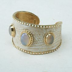 Bianca Cuff Inspired by the casual sophistication of the Hamptons, this cuff is a head turner! Cream-toned faux croc is layered over thick brass and topped with three smoky agate cabochons set in brass with white enamel rivet accents. Fashion Bracelets, Cuff Bracelets, Fashion Jewelry, Women Jewelry, Unique Jewelry, Liquid Gold, Love Fashion, Jewelery, Women Accessories