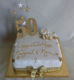 Gold roses bling 50th wedding anniversary cake created by MJ www.mjscakes.co.nz in sunny Hawkes Bay NZ