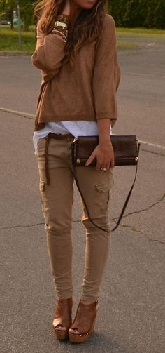cargo pants + wedge heels + clutch + sweatshirt