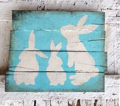 Spring Easter rabbits on turquoise distressed recycled pallet wood on Etsy, $55.00