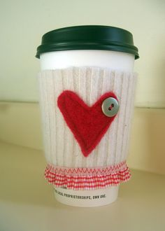 So cute! :)    Red Heart and Gingham Coffee Cozy Sleeve: felted, recycled sweater.  Featured in Simply Handmade Magazine.. $6.00, via Etsy.