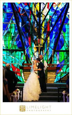 Limelight Photography, www.stepintothelimelight.com, Weddings, Grace Lutheran Church, St. Petersburg, Florida, Stained Glass, Kiss, Ceremony, Bride, Wedding Dress, White, Groom, Blue, Black, Green