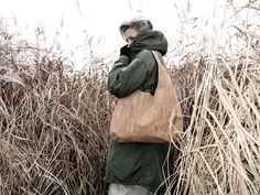 Natural raw cork color goes perfectly with olive-green parka. Available on our website! http://www.oak-bags.com/
