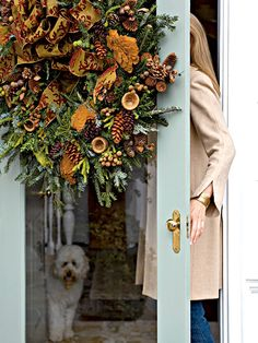 This Fraser fir wreath is embellished with berries, dried mushrooms, monkeypods, and different shades of brown pinecones dipped in wax for a lush new look. A gold-and-burgundy ribbon complements the colors of the natural elements. (Photo: Brie Williams)