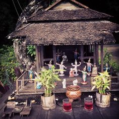 I love Thai spirit houses, note loungr chairs front left.