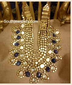 22 carat gold encrypted mind blowing bridal jadau necklace from Ksrala. Syndicate Polki and Tanzanite stones combination grand kundan jadau set enhanced with blue sapphire beads Indian Wedding Jewelry, Wedding Jewelry Sets, Indian Jewelry, Bridal Jewelry, Gold Jewelry, Fine Jewelry, Quartz Jewelry, 90s Jewelry, Jewelry Accessories
