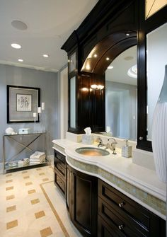 Loving the rich detail of this bathroom.