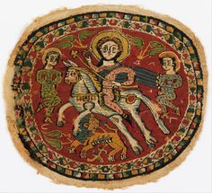 Coptic medallion with polychrome figures on a red ground. The image is said to represent the Byzantine Emperor Heraclius with two Persian prisoners, a reference to his victory over the Persians in 627; 6th-7th century Egypt