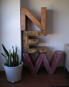 Pallet Room Dividers: Spanish upcycler Carlos makes awesome pallet room dividers from giant letters. More pallet design DIY ideas and inspiration at http://pinterest.com/wineinajug/passion-for-pallets/