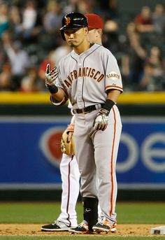 Norichika Aoki of the San Francisco Giants signals for a two bases after hitting a ground rule double against the Arizona Diamondbacks during the fifth inning of the MLB game at Chase Field on Tuesday, April 7, 2015, in Phoenix, Ariz.  (Christian Petersen/Getty Images)
