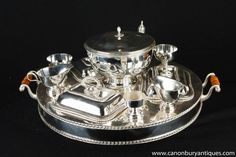 - Stunning Victorian style silver plate lazy susan - or dumb waiter<BR> - Great piece for the high end dinner party<BR> - The main piece revolves and is used as part of a dinner service<BR> - Various hot plates, dishes, gravy boats and the central urn<BR> - All can be heated by keeping hot water in main body of service<BR> - All that's missing is your very own butler to come with the piece for the full Downton Abbey experience<BR> - Please see close up photos of factory stamp on the…