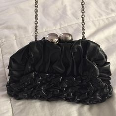 🎀Black Clutch Bag Black Clutch bag with Silver detachable chain very cute, can be worn any way you like it. The chain is detachable so it gives you 2 different options.   It was purchased for $45 and it's only been used once or twice. Listing price $30 or make me an offer I can't say no to! Bags Clutches & Wristlets