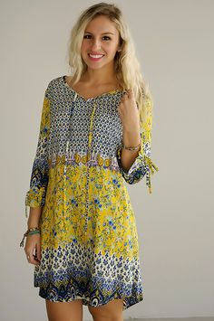 LOVE the colors in this one. Go For It Peasant Dress