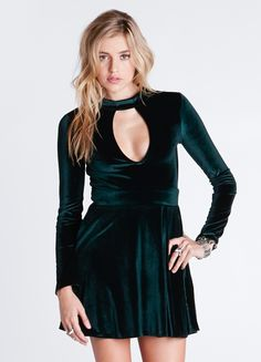 """Longsleeve fit-n-flare dress featuring a mock neck and keyhole opening at bust. Hidden zipper at back.  By For Love & Lemons 92% Polyester, 8% Spandex 30"""" bust 26"""" waist 32"""" length Model is wearing size S"""
