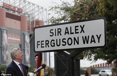 Sir Alex Ferguson unveils a sign on the street named in his honour near Old Trafford