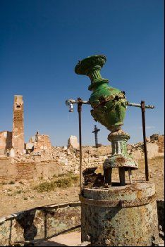 """Ruined fountain stands forlorn in Belchite. Belchite offers a unique place to visit in Spain and is a monument to the Spanish civil war which tore through the country between 1936 and 1939. Left """"as is"""" after the war this battle destroyed village in Aragon offers visitors a chance to appreciate both the history of Spain as well as an understanding of the innocents that are affected by any conflict."""